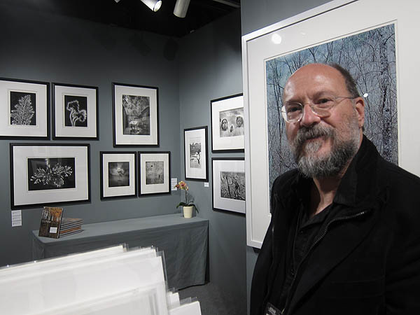 David Scheinbaum at his space, with prints by Walter Chappell
