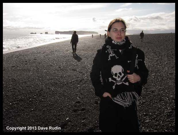 Aubrey on the black sand beach near Vik