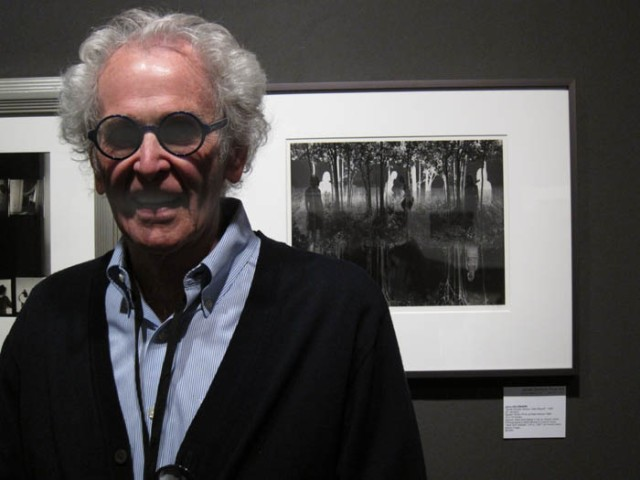 Jerry Uelsmann with one of his prints at Janet Sirmon Fine Art
