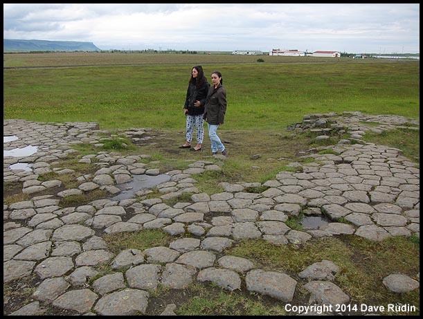 "Nadine and Rebecca at Kirkjugolf (""church floor"") - in reality the upper end of natural basalt columns in the ground - in Kirkjubæjarklaustur"