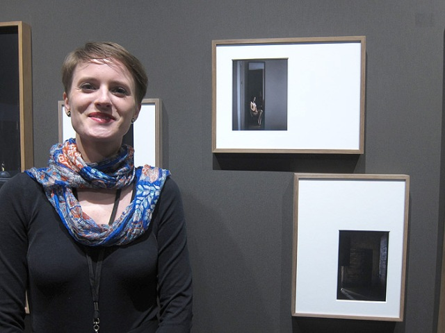 Photographer Judith Stenneken with some of her prints at Galerie 5,6