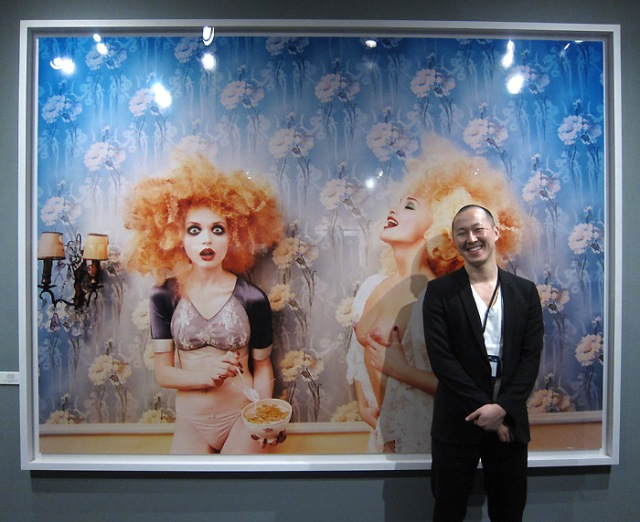 George K. of the Staley-Wise Gallery with a David LaChapelle print